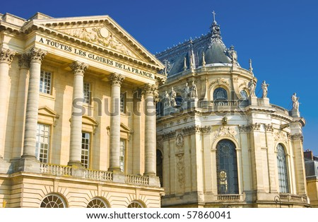 Beautiful palace facade with columns and statues in Versailles, France - stock photo