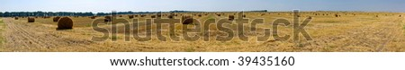 Beautiful panorama a haystack against the dark blue sky - stock photo