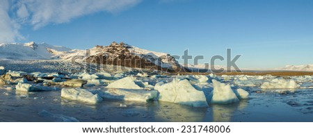 Beautiful panorama of mountains, glaciers and icebergs during sunset at Glacier lagoon, Iceland