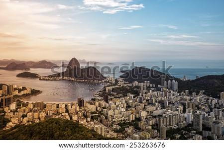 Beautiful panorama of Rio de Janeiro during sunset with light leak, Brazil - stock photo