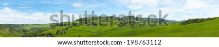 Beautiful panorama of Tuscany with the twisting road and cypresses - stock photo