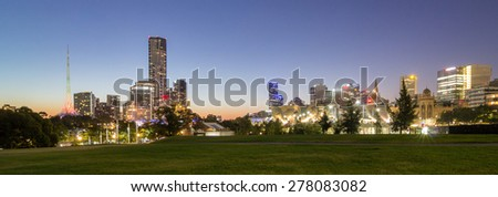 Beautiful Panorama View of Melbourne City Skyline, Eureka Tower, CBD, Southbank from the Park under Clear Blue Sky at Dusk in Summer Evening, Australia - stock photo