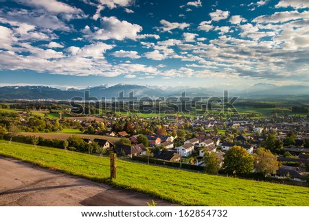 Beautiful panorama view to lake Zug and Swiss Alps from Albis in a beautiful autumn sunset, Central Switzerland - stock photo