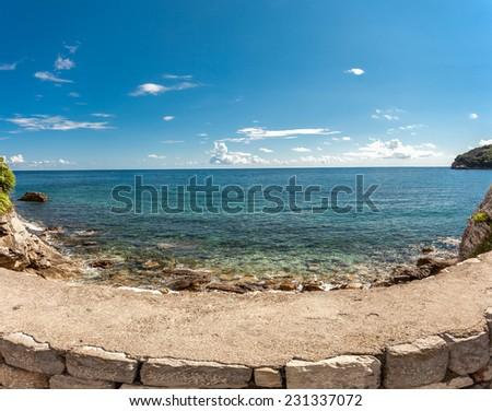 Beautiful panoramic photo of turquoise sea and cliffs at sunny day - stock photo