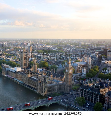 Beautiful panoramic scenic view on London's southern part from window of London Eye tourist attraction wheel cabin: cityscape, Westminster Abbey, Big Ben, Houses of Parliament and Thames river - stock photo