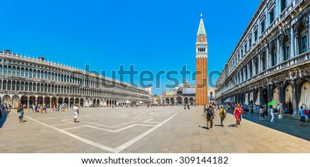Beautiful panoramic view of historic Piazzetta San Marco with Doge's Palace and famous St Mark's Campanile, Procuratie and coffee places on a sunny day with blue sky, Venice, Italy - stock photo