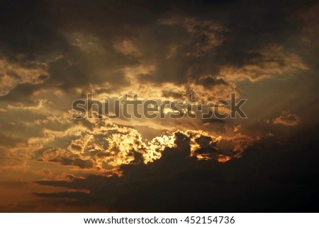 Beautiful panoramic view of sunset sky, spectacular cloudscape and sun rays. Glowing, fantasy, stratosphere, atmosphere, environment, landscape, shadow. - stock photo