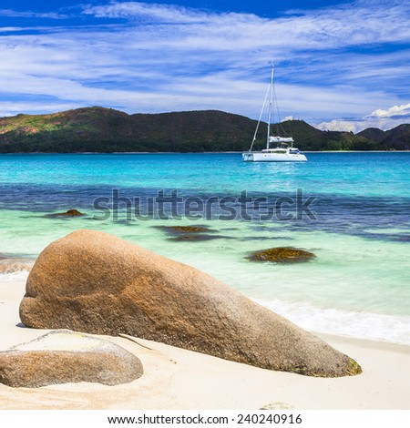 beautiful panoramic view of the beach with yacht, Seychelles - stock photo