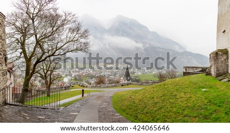 Beautiful panoramic view of the cloudy mountains located in Liechtenstein near Switzerland. View form the Gutenberg castle. - stock photo