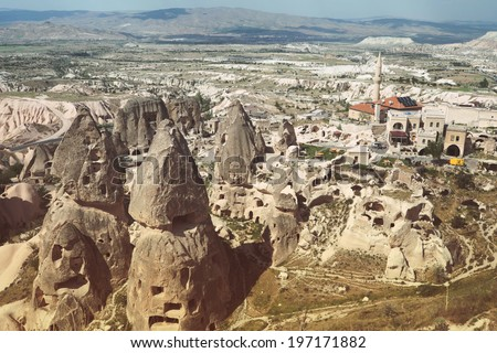 "Beautiful panoramic view to the cave / underground city from the Uchisar town's castle in Turkey, Cappadocia region, most visually striking region having a ""moonscape"" landscape"
