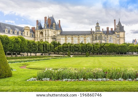 Beautiful Park with and ancient Fontainebleau palace. Palace of Fontainebleau - one of largest Medieval royal chateaux in France (55 km from Paris), UNESCO World Heritage Site.