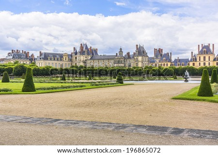 Beautiful Park with and ancient Fontainebleau palace. Palace of Fontainebleau - one of largest Medieval royal chateaux in France (55 km from Paris), UNESCO World Heritage Site. - stock photo