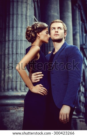 Beautiful passionate couple over city background. Fashion style photo. - stock photo