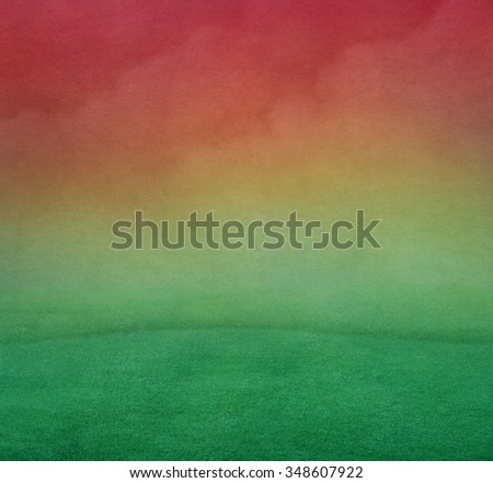 Beautiful pastel background with pink sky and green field - stock photo
