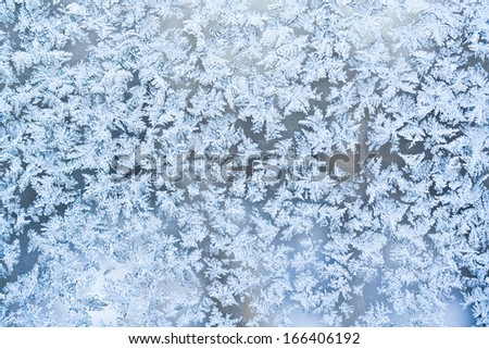 Beautiful pattern of frost on  winter window - stock photo