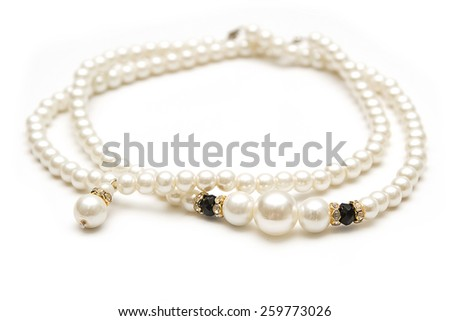 Beautiful pearl necklace on white - stock photo