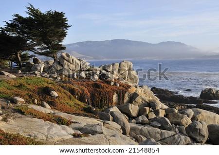 Beautiful  pebble  beach with romantic coastline - stock photo