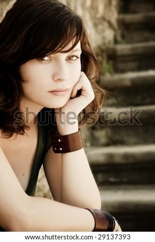 Beautiful pensive woman staring at camera. - stock photo