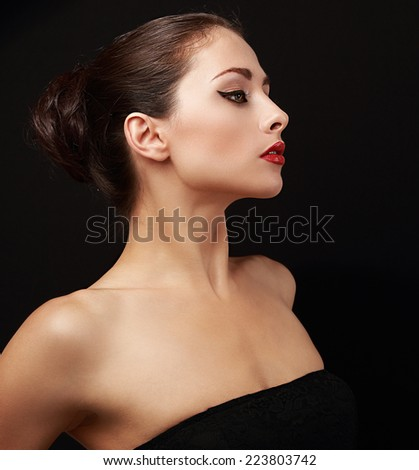 Beautiful perfect female model profile looking sexy. Closeup portrait on black background - stock photo