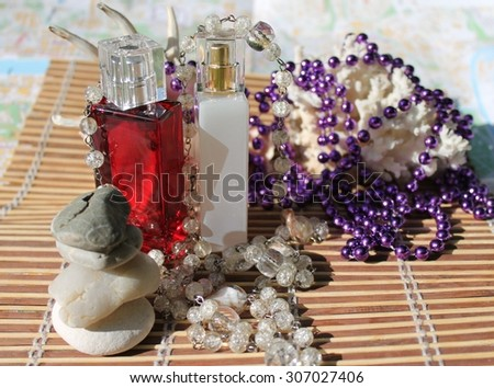 Beautiful perfume bottles, red and white. - stock photo