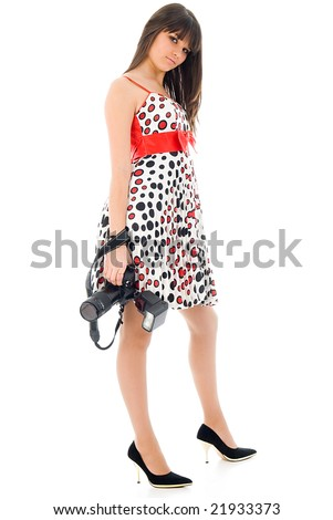Beautiful photographer, young girl in nice dress with dslr camera in hands