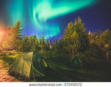 Beautiful picture of massive multicolored vibrant Aurora Borealis, Aurora Polaris, also know as Northern Lights in the night sky over Norway, Lofoten Islands  - stock photo