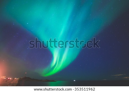Beautiful picture of massive multicoloured vibrant Aurora Borealis, Aurora Polaris, also know as Northern Lights in the night sky over Norway, Lofoten Islands - stock photo