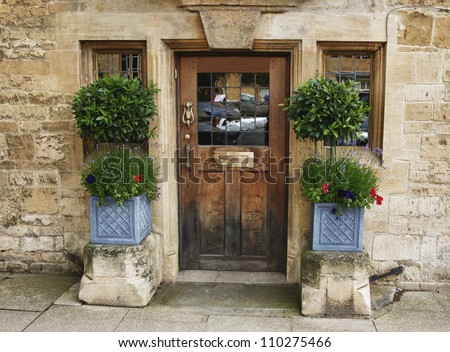 Beautiful picturesque cottage entrance in the village of Chipping Campden, Cotswold, United Kingdom. - stock photo