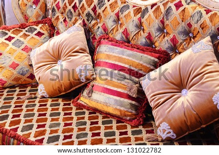 Beautiful pillows on a magnificent sofa - stock photo