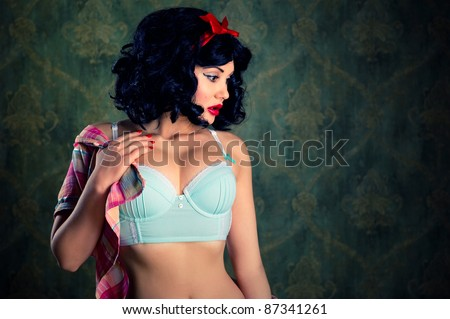 Beautiful pin-up girl indoors - stock photo