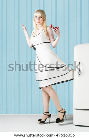 Beautiful Pin-up girl with cocktail - stock photo