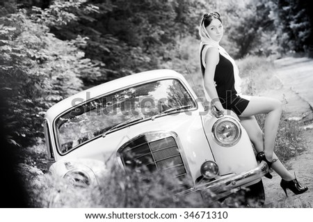 Beautiful pin-up styled girl, grayscale - stock photo
