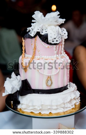 beautiful pink cake with decorations for a party cream - stock photo