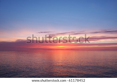 Beautiful pink colors reflect off Lake Superior in northern Michigan - stock photo