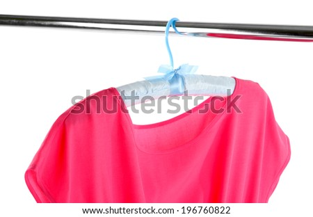 Beautiful pink dress hanging on hangers isolated on white