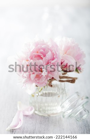 beautiful pink peony flowers bouquet in vase  - stock photo