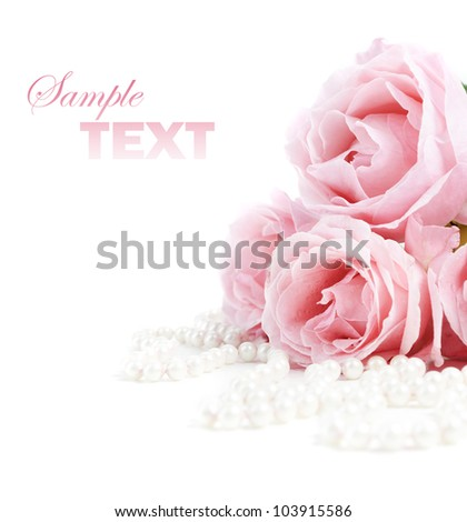 Beautiful pink roses and white pearls - stock photo