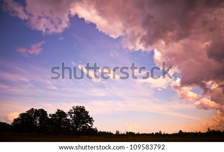 Beautiful pink summer sunset in the countryside - stock photo