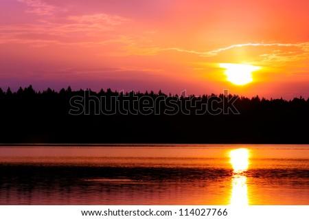 Beautiful Pink Sunset over Lake - stock photo