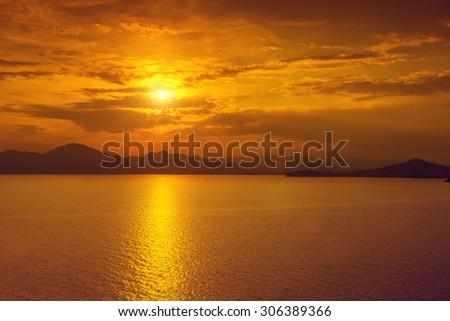 Beautiful pink sunset over sea - stock photo