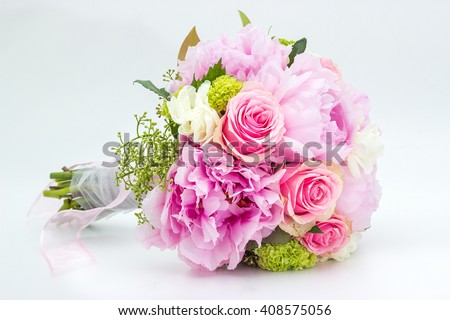 Beautiful pink wedding bouquet on a white background - stock photo