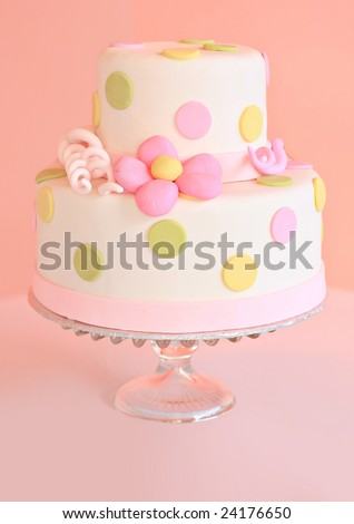 Beautiful pink wedding cake, shallow dof, focus on center of the cake. - stock photo