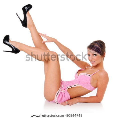 Beautiful Pinup Girl in Maid outfit - stock photo