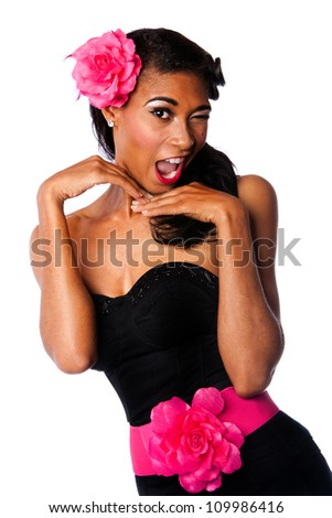 Beautiful pinup girl with pink flowers and black corset winking playfully, isolated. - stock photo