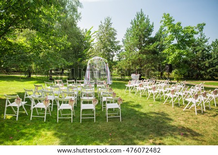 Beautiful place outside wedding ceremony city stock photo beautiful place for outside wedding ceremony in city park many white wooden chairs decorated with junglespirit Choice Image