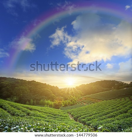 Beautiful place with nice rainbow - stock photo