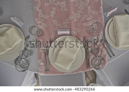 beautiful plates and glasses are on the table