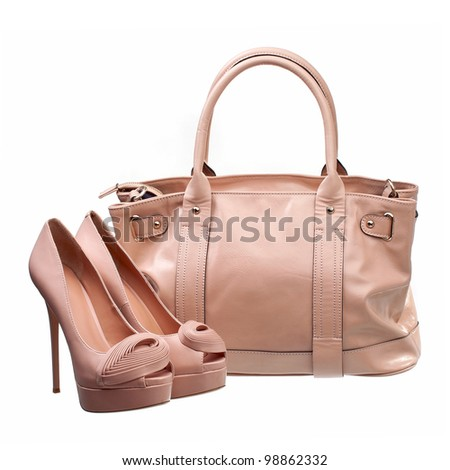 Beautiful platform shoes and handbag over white - stock photo