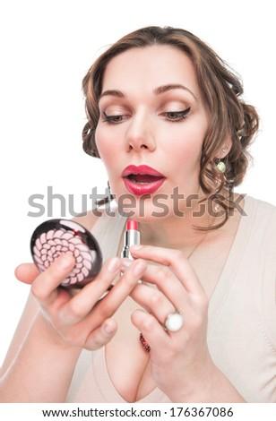 Beautiful plus size woman applying lipstick  - stock photo