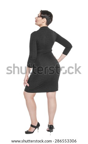 Beautiful plus size woman in black dress posing isolated on white background - stock photo